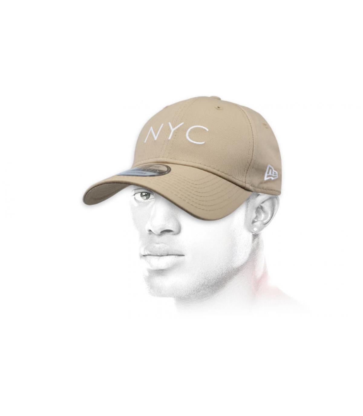 beige NYC cap