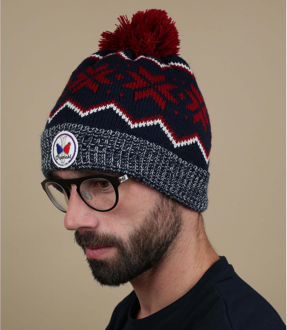 blauwe hoed rood patroon