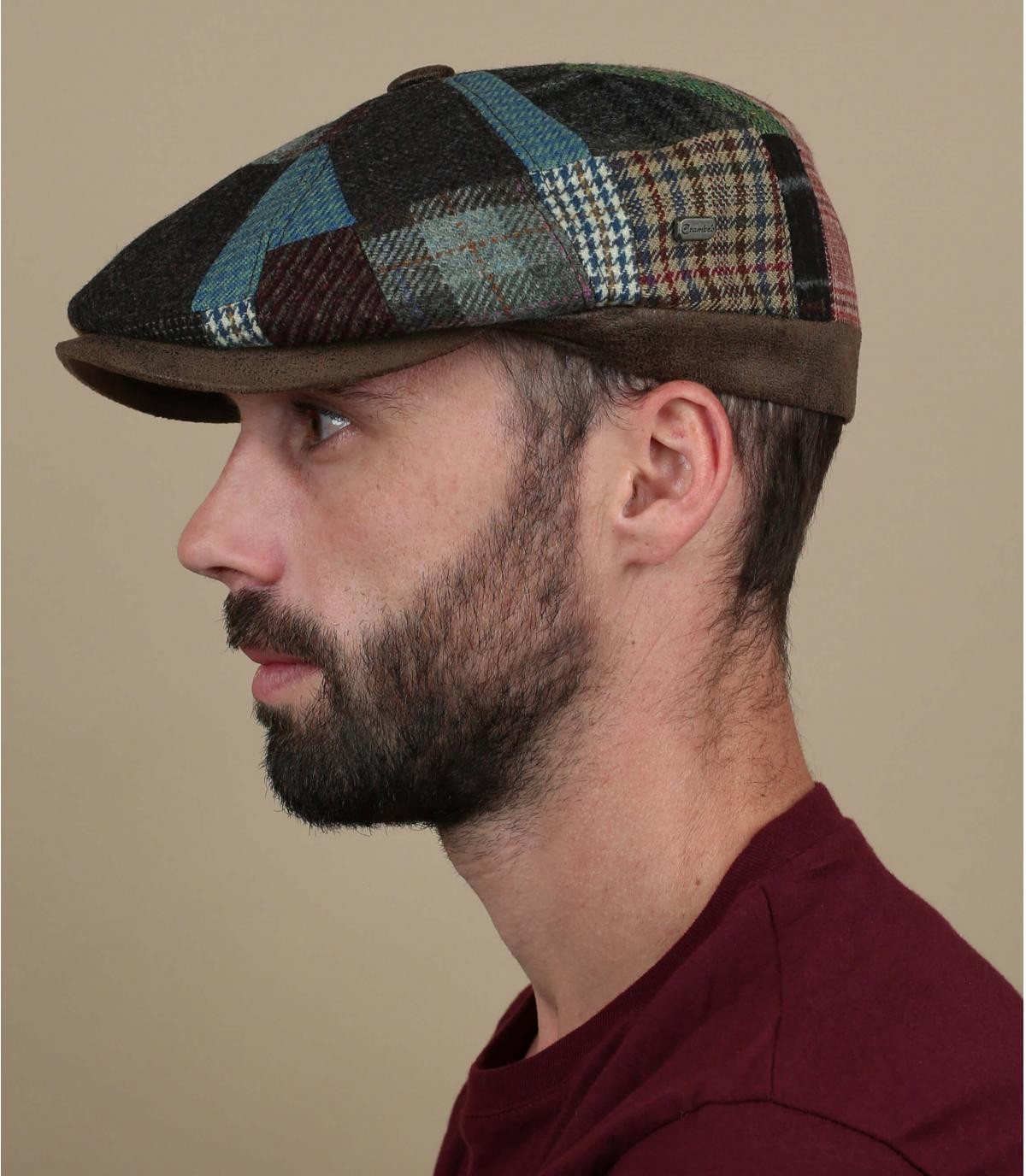 bruine patchwork krantenverkoper baret