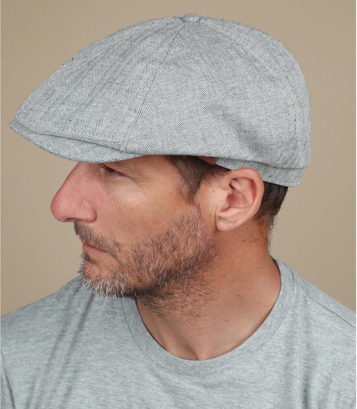 grijze linnen krantenverkoper baret