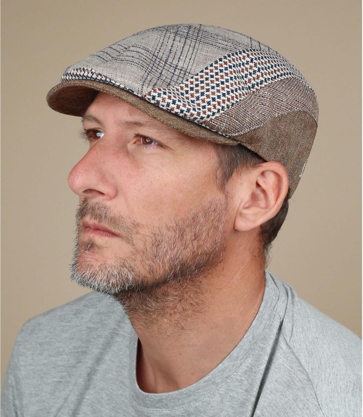 beige gestreepte linnen baret