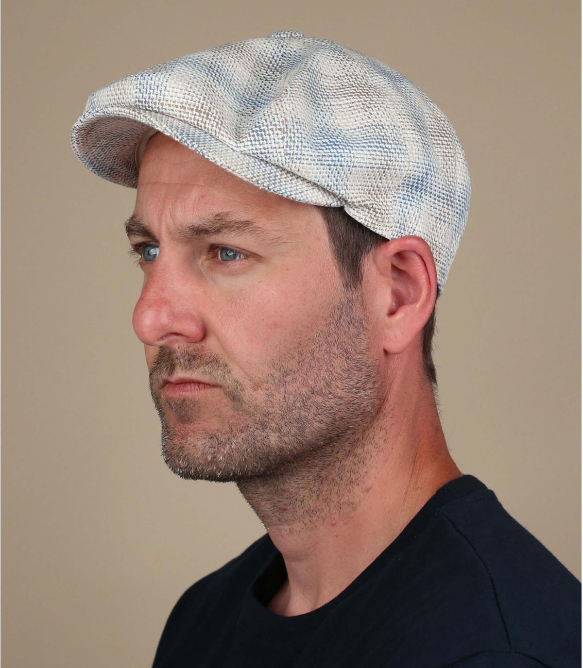 blauw beige krantenverkoper baret