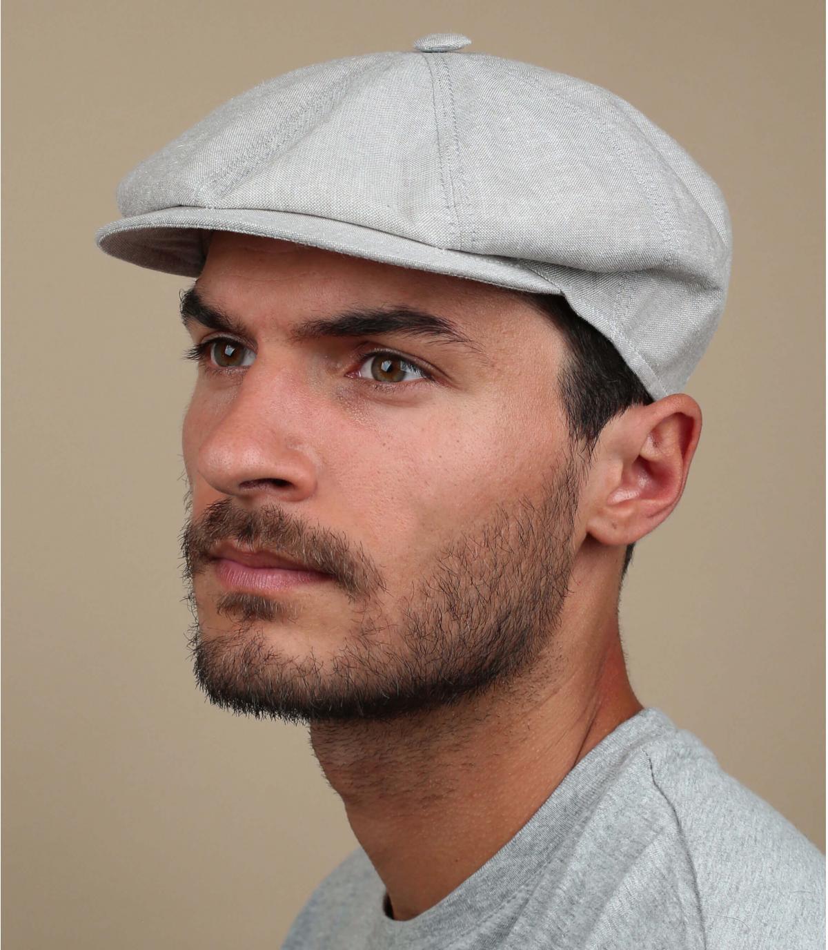 grijze krantenverkoper baret