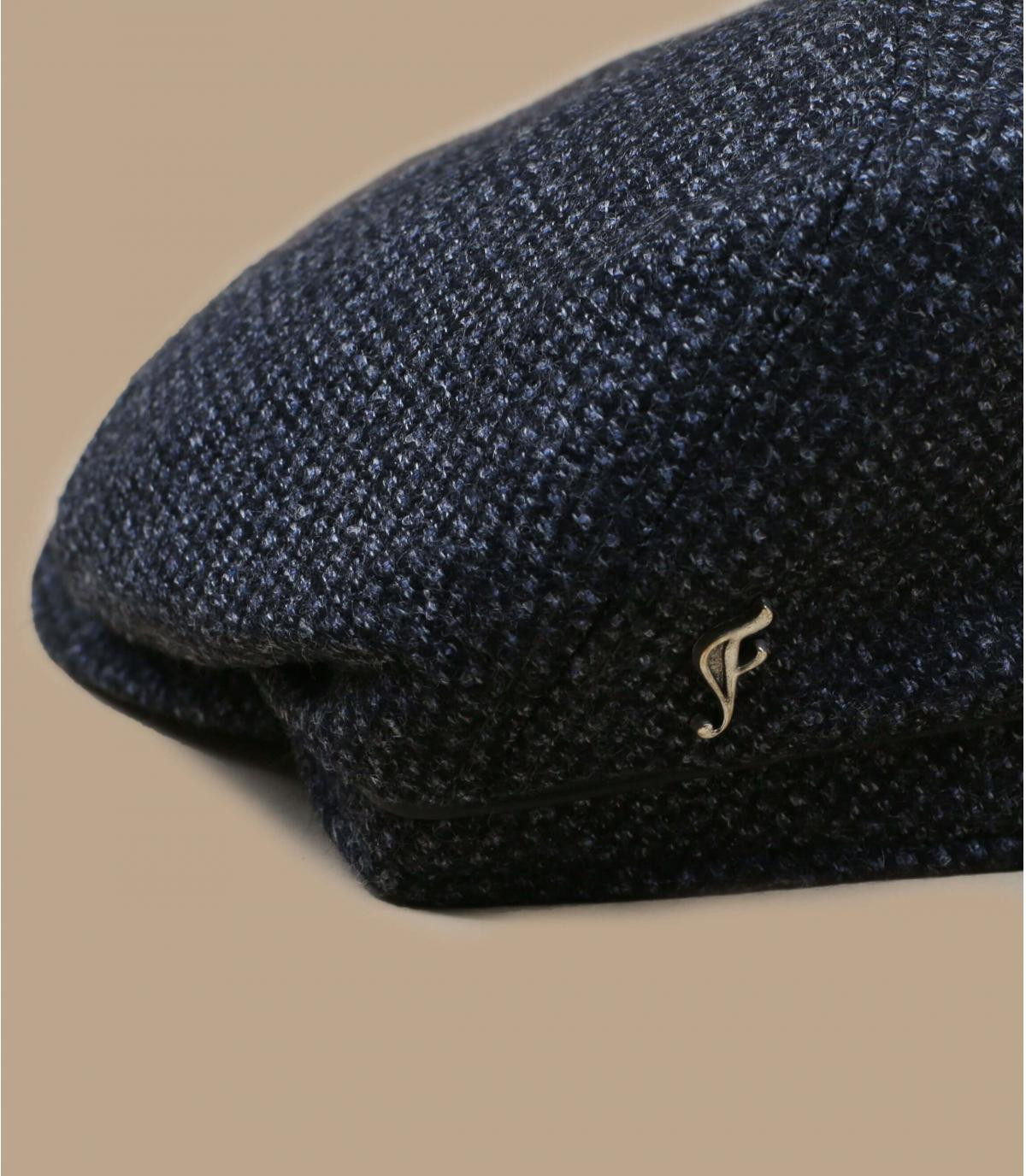 blauwe wol krantenverkoper baret