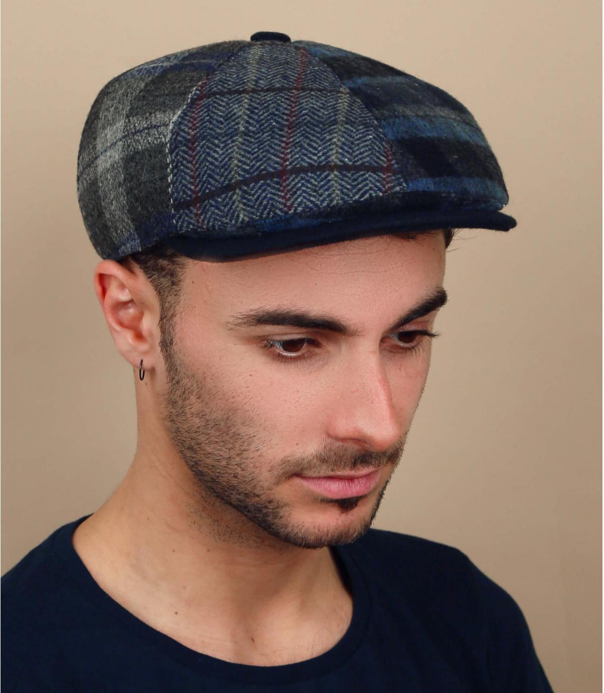 blauwe krantenverkoper baret