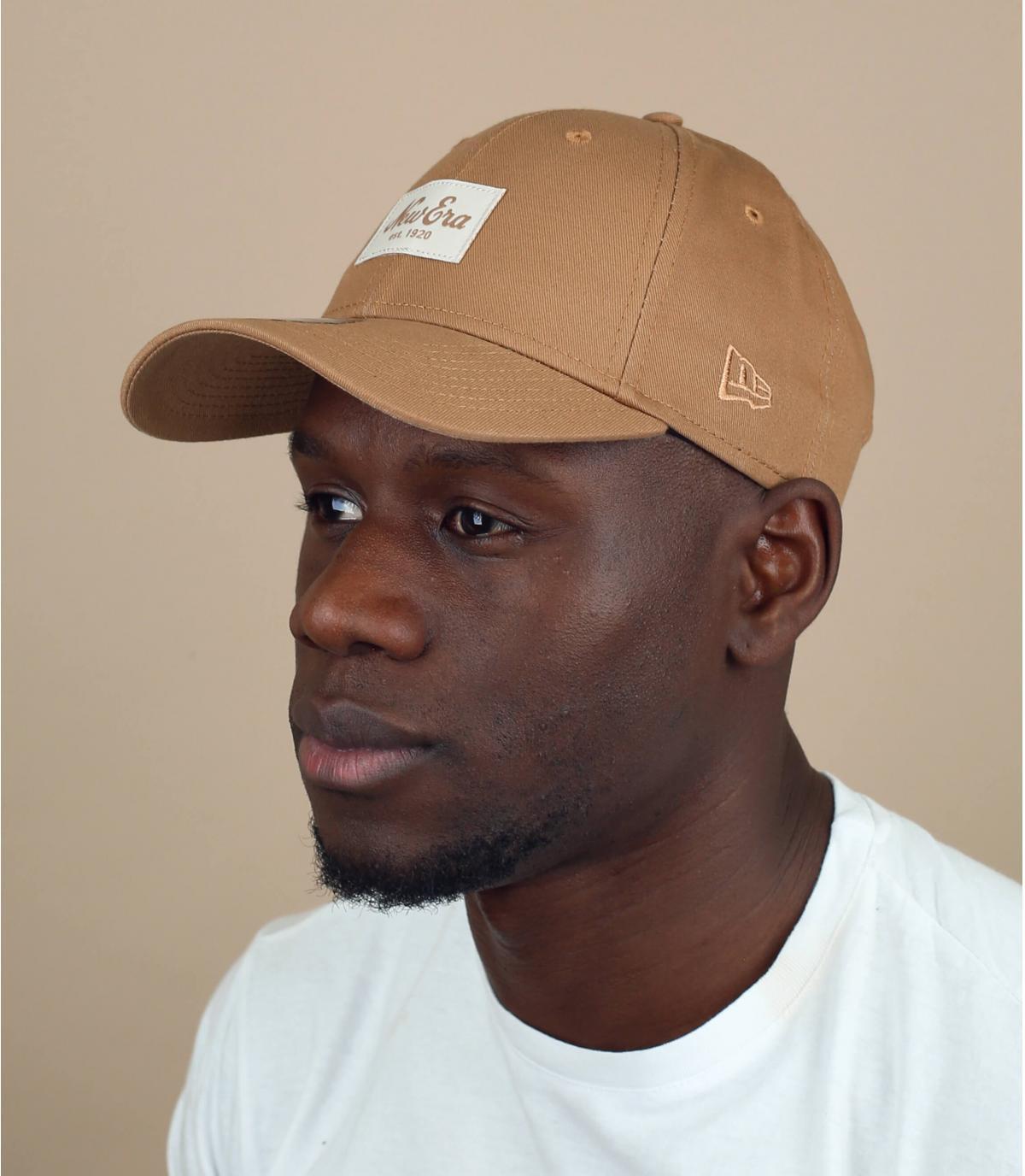 beige New Era cap